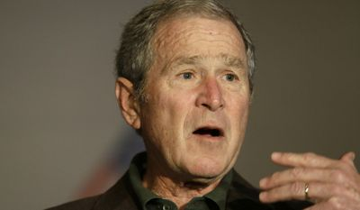 Former President George W Bush speaks during a preview of an exhibition of his paintings of U.S. military veterans in Dallas, Tuesday, Feb. 28, 2017. President Bush says he didn't intend to criticize President Donald Trump when he said recently that a free press is essential to democracy. (AP Photo/LM Otero)