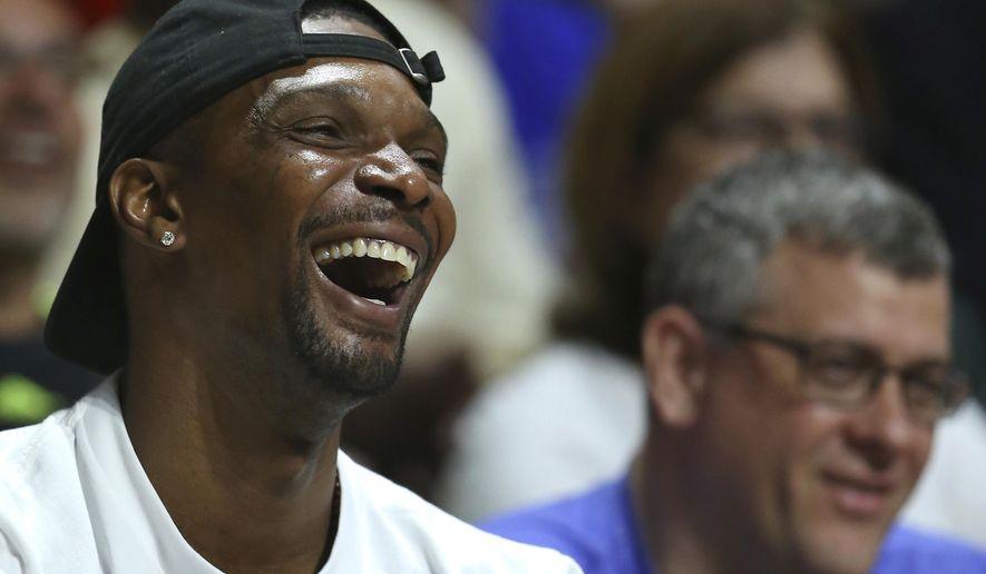 Miami Heat forward Chris Bosh smiles during the first half of an NCAA college basketball game between Miami and Duke in Coral Gables, Fla., on Saturday, Feb. 25, 2017. (David Santiago /El Nuevo Herald via AP)