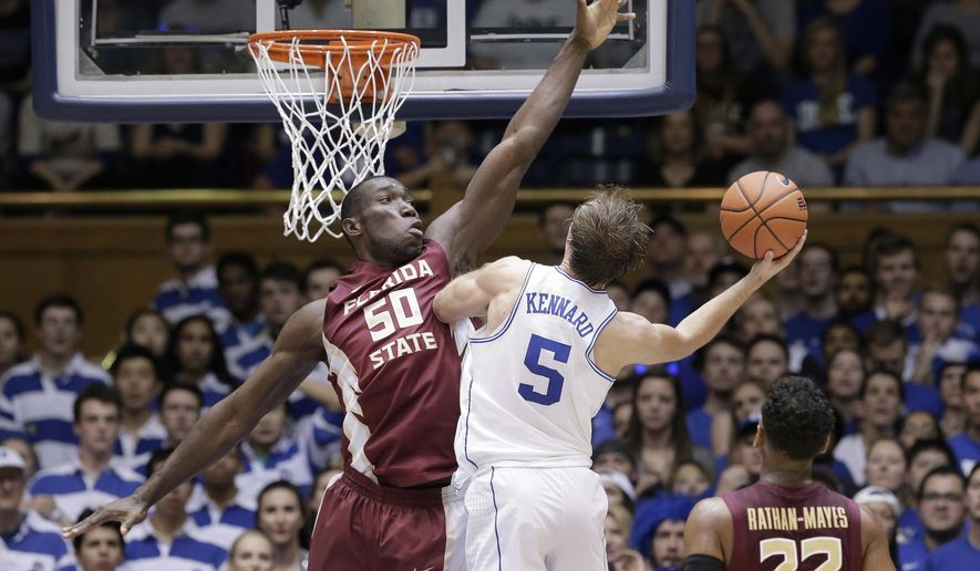 Duke's Luke Kennard (5) drives to shoot as Florida State's Michael Ojo (50) defends during the first half of an NCAA college basketball game in Durham, N.C., Tuesday, Feb. 28, 2017. (AP Photo/Gerry Broome)