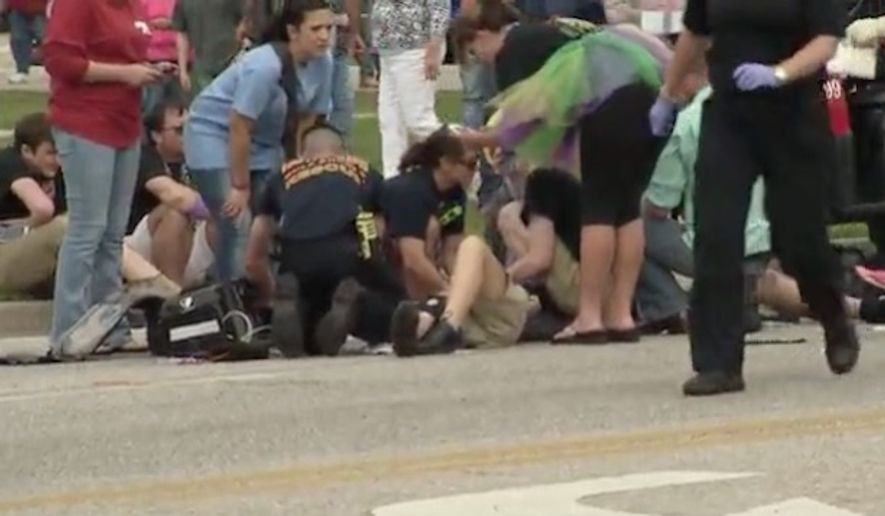 A car drove into a crowd at a Mardi Gras parade in Gulf Shores, Alabama, Tuesday morning, reportedly injuring at least 11 high school marching band members. (WKRG)