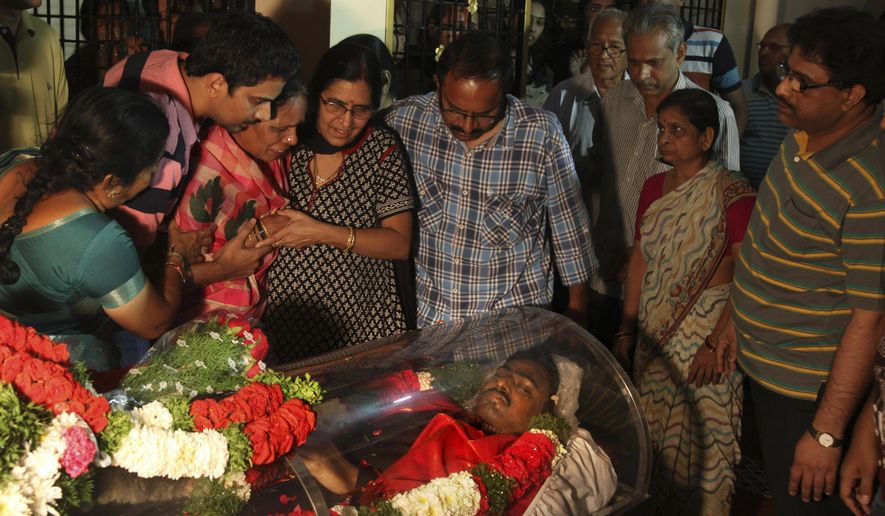 Relatives grieve around the body of Srinivas Kuchibhotla after the body was flown from the US to his residence on the outskirts of Hyderabad, India, Tuesday, Feb. 28, 2017. Kuchibhotla, 32, was killed in Wednesday night's shooting at Austins Bar and Grill in Olathe, Kansas and another person was wounded. (AP Photo /Mahesh Kumar A.)