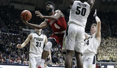 Indiana's Robert Johnson puts up a shot against Purdue's Caleb Swanigan during the first half of an NCAA college basketball game Tuesday, Feb. 28, 2017, in West Lafayette, Ind. (AP Photo/Darron Cummings)