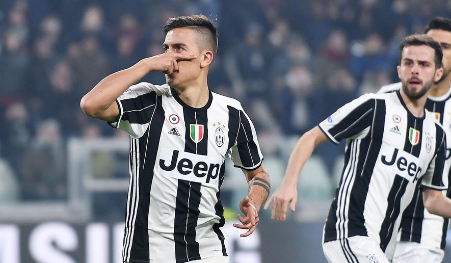 Juventus' Paulo Dybala celebrates after scoring during the Italian Cup first leg semifinal soccer match between Juventus and Napoli, at the Juventus Stadium in Turin, Italy, Tuesday, Feb. 28, 2017. (Andrea Di Marco/ANSA via AP)