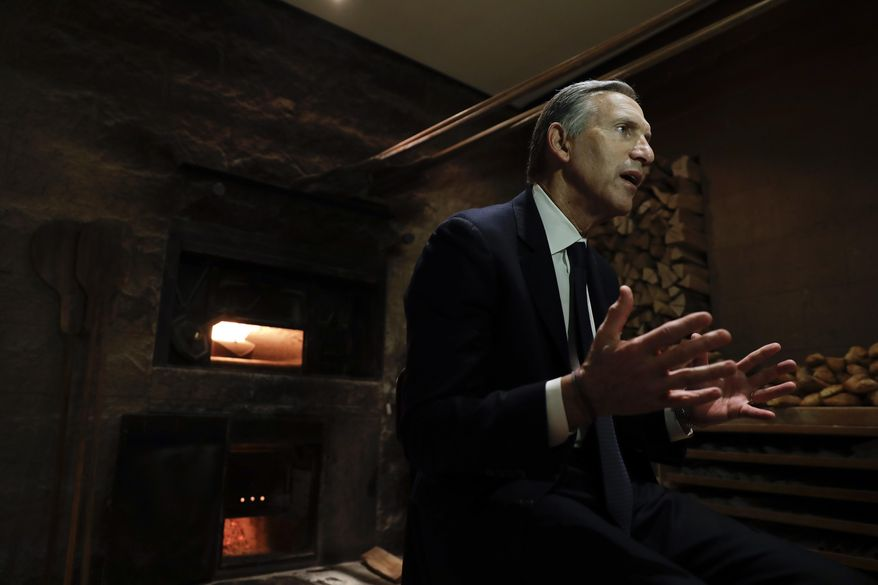 In this image taken on Monday, Feb. 27, 2017, Starbucks CEO Howard Schultz gestures during an interview with the Associated Press at a Princi bakery in Milan, Italy. Longtime CEO Howard Schultz's vision for Starbucks was largely inspired by the Milan coffee bars he experienced on his first trip to the northern Italian city in 1983. Schultz will continue on with the company to open ''the quintessential Roastery'' in Milan by the end of 2018. (AP Photo/Luca Bruno)