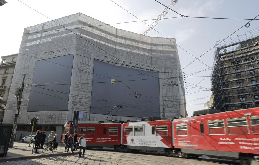 In this image taken on Monday, Feb. 27, 2017, a view of the old headquarters of the Italian post during renovation works to host the Starbucks cafeteria in Milan, Italy. Longtime CEO Howard Schultz's vision for Starbucks was largely inspired by the Milan coffee bars he experienced on his first trip to the northern Italian city in 1983. Schultz will continue on with the company to open ''the quintessential Roastery'' in Milan by the end of 2018. (AP Photo/Luca Bruno)