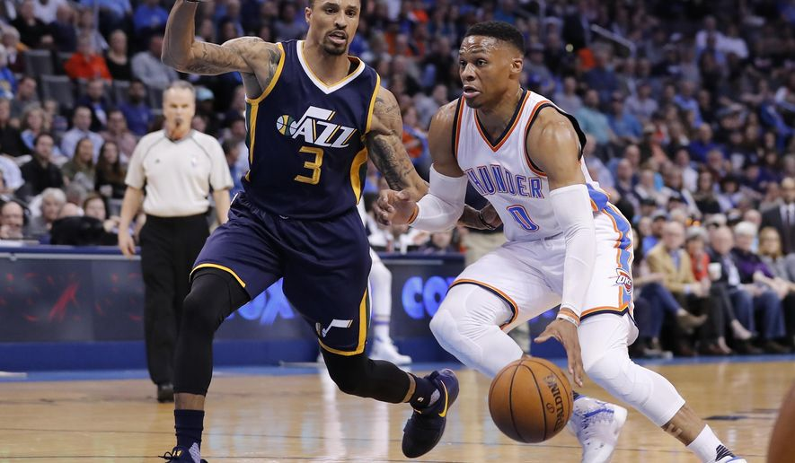 Oklahoma City Thunder guard Russell Westbrook (0) drives to the basket against Utah Jazz guard George Hill (3) during the first half of an NBA basketball game in Oklahoma City, Tuesday, Feb. 28, 2017. (AP Photo/Alonzo Adams)