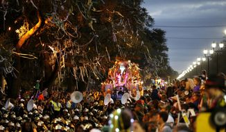A flat follows a marching band during the Krewe of Bacchus Mardi Gras parade in New Orleans, Sunday, Feb. 26, 2017. (AP Photo/Gerald Herbert)