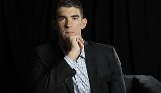 FILE - In this Tuesday, Oct. 25, 2016, file photo, former Olympic swimmer Michael Phelps poses for a portrait while attending the Quickbooks Connect conference as a featured speaker in San Jose, Calif. Phelps is set to testify before a Congressional panel Tuesday, Feb. 28, 2017, in support of more consistent drug testing for competitive athletes. (AP Photo/Marcio Jose Sanchez, File)