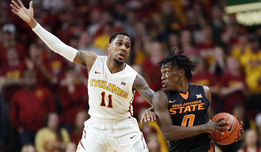 Oklahoma State guard Brandon Averette, right, drives around Iowa State guard Monte Morris during the first half of an NCAA college basketball game, Tuesday, Feb. 28, 2017, in Ames, Iowa. (AP Photo/Charlie Neibergall)