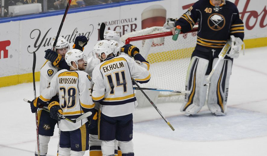 Nashville Predators celebrate a goal during the third period of an NHL hockey game against the Buffalo Sabres, Tuesday, Feb. 28, 2017, in Buffalo, N.Y. (AP Photo/Jeffrey T. Barnes)