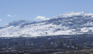 Sunshine prevailed across the snow-covered Sierra foothills and ridge tops halfway between Reno and Lake Tahoe to the southwest in this photo taken in Reno, Nevada on Tuesday, Feb. 28, 2017. The Mount Rose ski resort, top left, already has received a record 54 feet of snow this season. Lake Tahoe has reached its highest level since 2006.(AP Photo/By Scott Sonner).