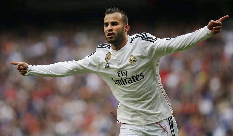 FILE - In this April 11, 2015 file photo, Real Madrid's Jese Rodriguez celebrates his goal during a Spanish La Liga soccer match between Real Madrid and Eibar at the Santiago Bernabeu stadium in Madrid. Jese Rodriguez has struggled since leaving Real Madrid last summer, and he will be facing his former club on Wednesday, March 1, 2017 for the first time looking to end Las Palmas' four-game losing streak. (AP Photo/Andres Kudacki, File)