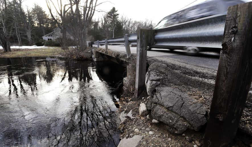 A vehicle travels over a bridge in need of repair on Hilldale Avenue over the Pow Wow River, Tuesday, Feb. 28, 2017, in South Hampton, N.H. Gov. Chris Sununu pledged to invest millions of dollars in repairing roads, bridges and schools in his budget address. (AP Photo/Elise Amendola)