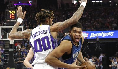 Minnesota Timberwolves center Karl-Anthony Towns goes to the basket against Sacramento Kings center Willie Cauley-Stein during the first half of an NBA basketball game Monday, Feb. 27, 2017, in Sacramento, Calif. (AP Photo/Rich Pedroncelli)