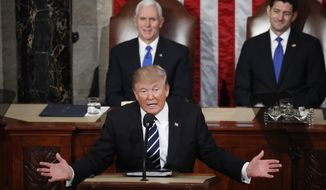 President Donald Trump addresses a joint session of Congress on Capitol Hill in Washington, Tuesday, Feb. 28, 2017, as Vice President Mike Pence and House Speaker Paul Ryan of Wis. listen. (AP Photo/Pablo Martinez Monsivais)