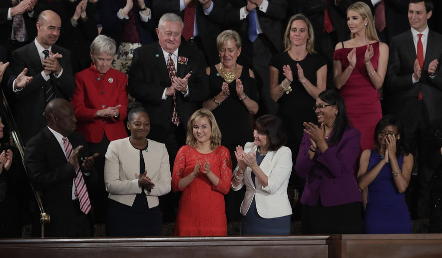 Denisha Merriweather, second from  left, is applauded while being acknowledged by President Donald Trump during his address to a joint session of Congress on Capitol Hill in Washington, Tuesday, Feb. 28, 2017. (AP Photo/J. Scott Applewhite)