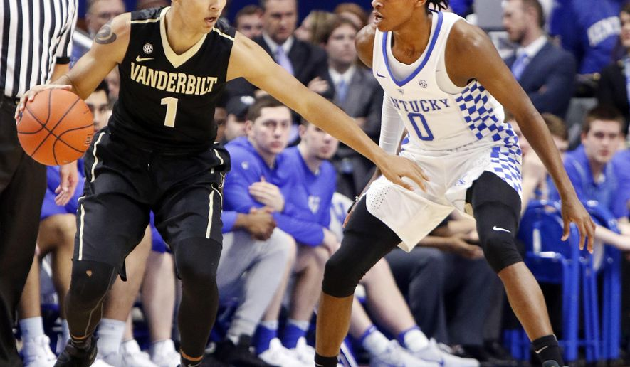 Vanderbilt's Payton Willis (1) looks for an opening on Kentucky's De'Aaron Fox (0) during the first half of an NCAA college basketball game, Tuesday, Feb. 28, 2017, in Lexington, Ky. (AP Photo/James Crisp)