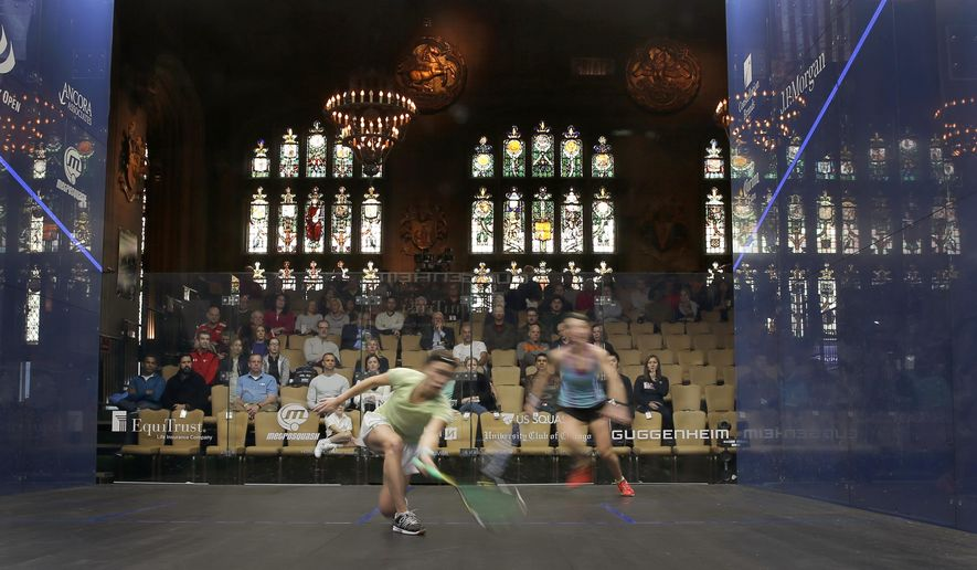 In this Saturday, Feb. 25, 2017, photo, Joey Chan, of Hong Kong, left, and Alison Waters, of England, compete during a Windy City Open squash tournament match in the historic Cathedral Room at the University Club of Chicago in Chicago. The world's top professional squash players from 21 countries are competing through March 1, in Chicago, one of eight World Series tournaments annually. (AP Photo/Charles Rex Arbogast)