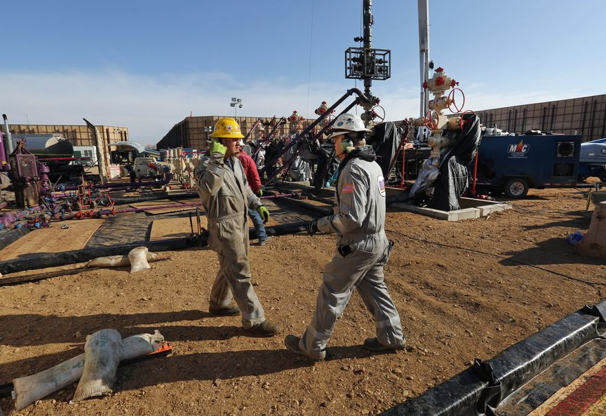 Hydraulic fracturing operations like this one near Mead, Colorado, have been blamed for a surge in earthquakes, but the U.S. Geological Survey says most of the shakes are not caused by fracking. (Associated Press)