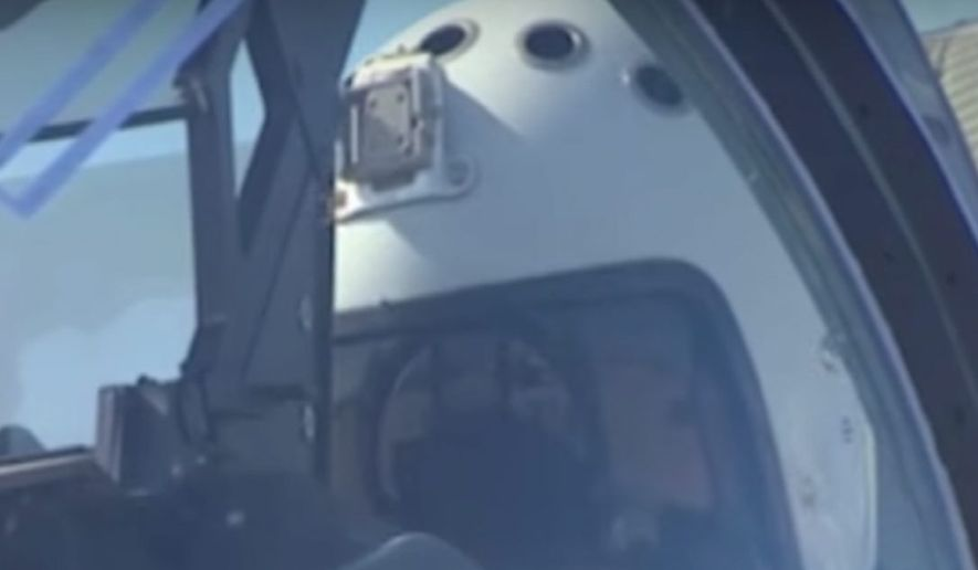 A video shows a Russian pilot flight-testing a jet equipped with a helmet mount from what analysts say appears to be for a GoPro video camera. The U.S. Navy has been slow to adopt the technology. (Russian Defense Ministry)