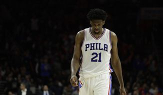 FILE - In this Jan. 11, 2017, file photo, Philadelphia 76ers' Joel Embiid walks down the court during an NBA basketball game against the New York Knicks in Philadelphia. Embiid's season is over because of continued issues with his left knee, the 76ers announced Wednesday, March 1, 2017. (AP Photo/Matt Slocum, File) **FILE**