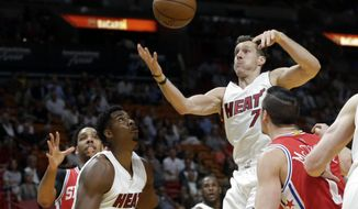 Miami Heat's Goran Dragic (7) goes for a loose ball on a turnover by Philadelphia 76ers' Jahlil Okafor, left, during the first half of an NBA basketball game, Wednesday, March 1, 2017, in Miami. (AP Photo/Lynne Sladky)