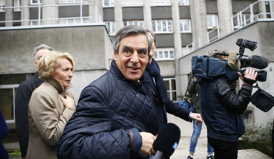 Conservative presidential candidate Francois Fillon leaves after delivering a speech in Paris, Wednesday, March 1, 2017. Fillon is refusing to quit the race despite receiving a summons Wednesday to face charges for alleged fake parliamentary jobs for his family. (AP Photo/Francois Mori)