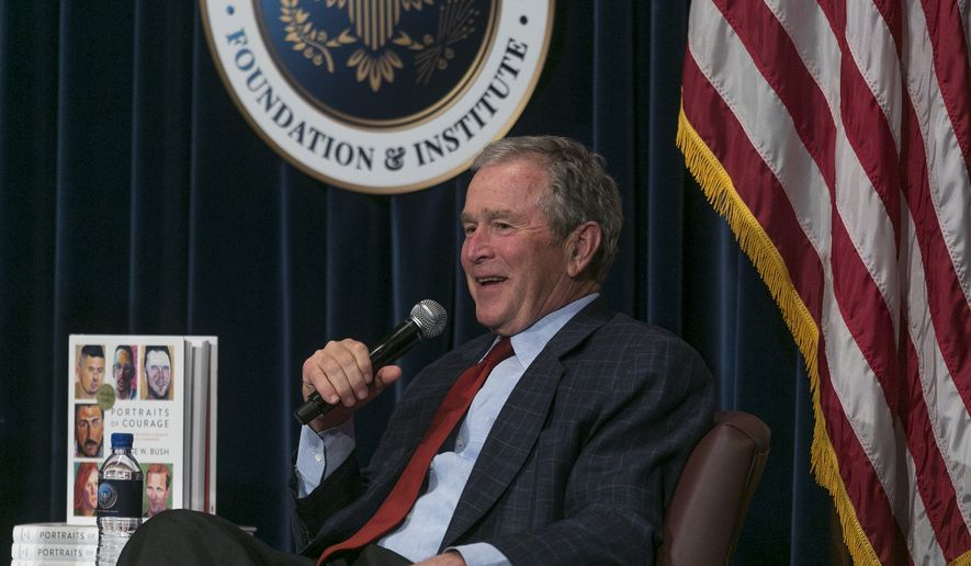 "Former U.S. President George W. Bush discusses his new book ""Portraits of Courage: A Commander in Chief's Tribute to America's Warriors,"" a collection of his artwork featuring paintings of veterans at the Ronald Reagan Presidential Library in Simi Valley, Calif., Wednesday, March 1, 2017. (AP Photo/Damian Dovarganes)"