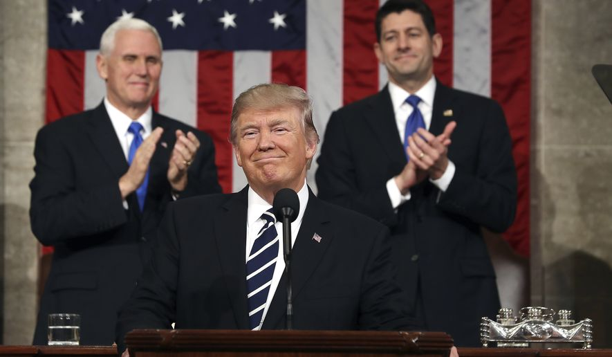 President Donald Trump, flanked by Vice President Mike Pence and House Speaker Paul Ryan of Wis., arrives on Capitol Hill in Washington, Tuesday, Feb. 28, 2017, for his address to a joint session of Congress. (Jim Lo Scalzo/Pool Image via AP)