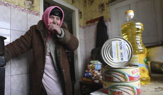 Maria Ivanovna receives humanitarian aid from the charitable foundation of Ukrainian billionaire Rinat Akhmetov, whose vast wealth is founded on the industrial output of Donetsk coal-rich region. The foundation said this month that its work in the region was paralyzed after rebels blocked access to the relief warehouse. (Associated Press/File)