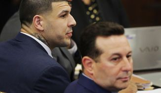 Former New England Patriots tight end Aaron Hernandez and his lead defense attorney Jose Baez, right, listen as the trial judge instructs the jury on the first day of Hernandez's double murder trial at Suffolk Superior Court on Wednesday, March 1, 2017, in Boston. Hernandez is standing trial for the July 2012 killings of Daniel de Abreu and Safiro Furtado who he encountered in a Boston nightclub. He is already serving a life sentence in the 2013 killing of semi-professional football player Odin Lloyd. (AP Photo/Stephan Savoia, Pool)