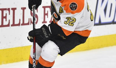 ADDS THAT STREIT SENT TO PENGUINS AFTER TRADED TO LIGHTNING - FILE - In this Nov. 2, 2016, file photo, Philadelphia Flyers' Mark Streit skates with the puck during an NHL hockey game against the Detroit Red Wings in Philadelphia. The Pittsburg Penguins sent a fourth-round pick in the 2018 draft to the Tampa Bay Lightning for Streit, just hours after the Lightning acquired Streit from Philadelphia on Wednesday, March 1, 2017.  (AP Photo/Derik Hamilton, File)