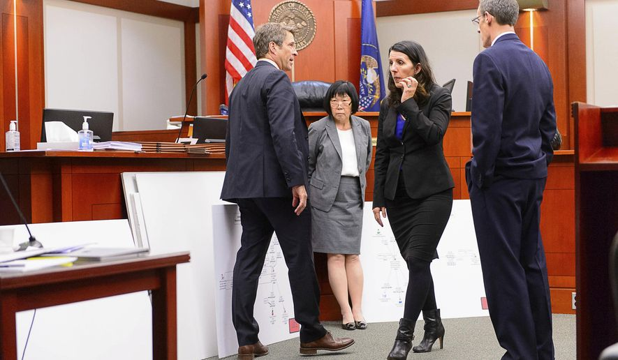 Defense attorney Scott C. Williams, Salt Lake County prosecutor Chou Chou Collins, defense attorney Cara Tangaro and Assistant Salt Lake County District Attorney Fred Burmester, look over exhibits during former Utah Attorney General John Swallow's trial in Salt Lake City, Tuesday, Feb. 28, 2017. Swallow presented a brief defense Tuesday as one of the biggest political scandals in state history sped toward jury deliberations. (Trent Nelson/The Salt Lake Tribune via AP, Pool)