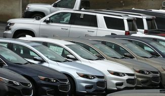 In this Thursday, Jan. 12, 2017, photo, Chevrolet cars sit on the lot of a dealer in Pittsburgh. Strong demand for pickups and SUVs helped brighten February 2017 for the U.S. auto industry. Overall sales of new vehicles were expected to fall slightly from last February as automakers cut back on deliveries to rental-car companies and other fleets. (AP Photo/Gene J. Puskar)