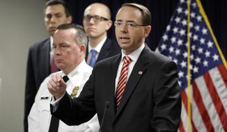 U.S. Attorney for the District of Maryland Rod J. Rosenstein, right, speaks at a news conference in Baltimore, Wednesday, March 1, 2017, to announce that seven Baltimore police officers who worked on a firearms crime task force are facing charges of stealing money, property and narcotics from people over two years. Standing alongside Rosenstein is Baltimore Police Department Commissioner Kevin Davis. (AP Photo/Patrick Semansky)