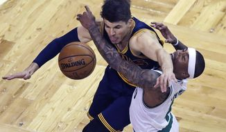 Boston Celtics guard Isaiah Thomas, right, and Cleveland Cavaliers guard Kyle Korver (26) collide while battling for the ball during the first quarter of an NBA basketball game in Boston, Wednesday, March 1, 2017. (AP Photo/Charles Krupa)