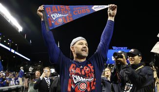 """FILE - In this Oct. 22, 2016, file photo, Chicago Cubs catcher David Ross celebrates after Game 6 of the National League baseball championship series against the Los Angeles Dodgers in Chicago. Ross, who retired after helping the Cubs win the World Series last year, is part of the 24th season of  """"Dancing with the Stars,"""" and his former teammates are excited to watch the ex-catcher on the show.  (AP Photo/Nam Y. Huh, File)"""