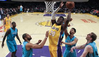 Los Angeles Lakers forward Julius Randle, center, goes up for a shot against Charlotte Hornets during the first half of an NBA basketball game Tuesday, Feb. 28, 2017, in Los Angeles. (AP Photo/Ringo H.W. Chiu)