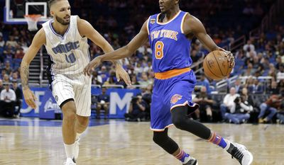 New York Knicks' Justin Holiday (8) looks to make a move around Orlando Magic's Evan Fournier (10) during the first half of an NBA basketball game, Wednesday, March 1, 2017, in Orlando, Fla. (AP Photo/John Raoux)
