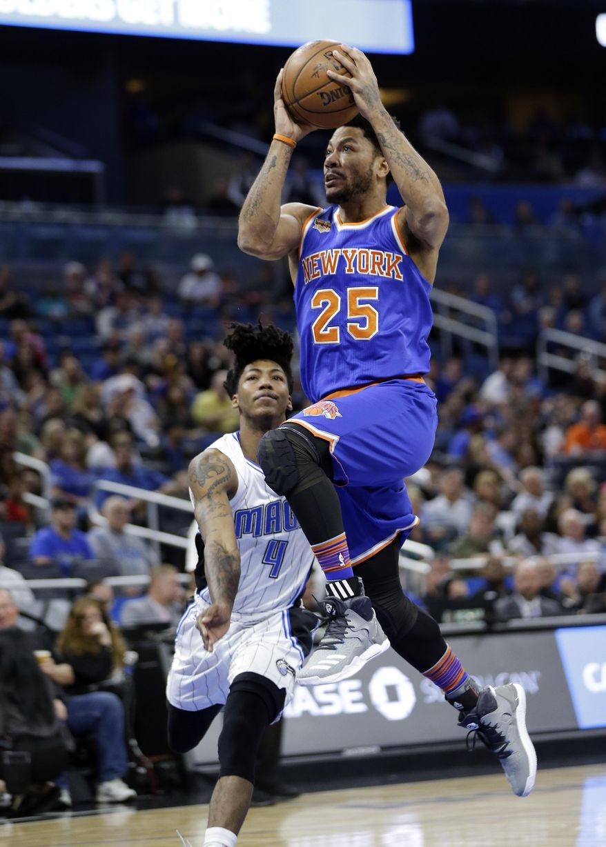 New York Knicks' Derrick Rose (25) goes up for a shot in front of Orlando Magic's Elfrid Payton (4) during the first half of an NBA basketball game, Wednesday, March 1, 2017, in Orlando, Fla. (AP Photo/John Raoux)