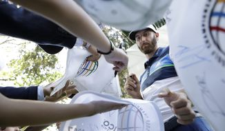 Dustin Johnson of the U.S. signs autographs for fans as he leaves the ninth hole after practicing on the high-altitude course at Chapultepec Golf Club a day before the start of the Mexico Championship, in Mexico City, Wednesday, March 1, 2017. All but one of the world's top 50 golfers will contest the World Golf Championship PGA event, which this year relocated to Mexico City from the Trump National Doral Resort in Florida. (AP Photo/Rebecca Blackwell)