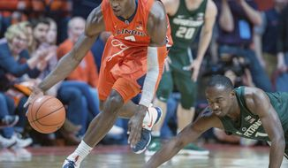 Illinois forward Kipper Nichols (2) takes off after making a steal on Michigan State guard Joshua Langford (1) during the first half of an NCAA college basketball game in Champaign, Ill., Wednesday, March 1, 2017. (AP Photo/Rick Danzl)