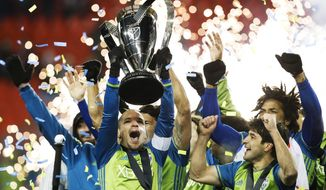 FILE - In this Dec. 10, 2016, file photo, Seattle Sounders midfielder Osvaldo Alonso, front left, hoists soccer's MLS Cup with teammates after defeating Toronto FC in the playoff game. Launched with 10 teams in 1996, MLS has plans to expand to 28 teams in coming years. (Mark Blinch/The Canadian Press via AP, File)