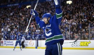 FILE - In this Sunday, Feb. 19, 2017, file photo, Vancouver Canucks' Jannik Hansen, of Denmark, celebrates his goal against the Philadelphia Flyers during the second period of an NHL hockey game in Vancouver, British Columbia. The San Jose Sharks have acquired Hansen from the Canucks late Tuesday, Feb. 28, 2017, for prospect Nikolay Goldobin and a conditional draft pick.  (Darryl Dyck/The Canadian Press via AP, File)