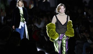 Models wear a creation for Dries Van Noten's Fall-Winter 2017-2018 ready to wear fashion collection presented in Paris, Wednesday, March 1, 2017. (AP Photo/Francois Mori)