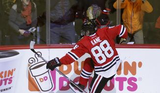 Chicago Blackhawks' Patrick Kane celebrates his goal during the second period of an NHL hockey game against the Pittsburgh Penguins on Wednesday, March 1, 2017, in Chicago. (AP Photo/Charles Rex Arbogast)