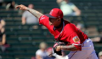 Los Angeles Angels pitcher Jesse Chavez throws during the first inning of a spring training baseball game against the Texas Rangers, Wednesday, March 1, 2017, in Tempe, Ariz. (AP Photo/Matt York)
