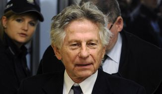 FILE - This Feb. 25, 2015 file photo shows filmmaker Roman Polanski during a break in a hearing concerning a U.S. request for his extradition over 1977 charges of sex with a minor, in Krakow, Poland. Los Angeles prosecutors on Wednesday, March 1, 2017, urged a judge to reject Polanski's efforts to unseal sworn testimony in his 1977 unlawful sex with a minor case, arguing the fugitive director must return to a Los Angeles court before his request can be considered. (AP Photo/Alik Keplicz, File)