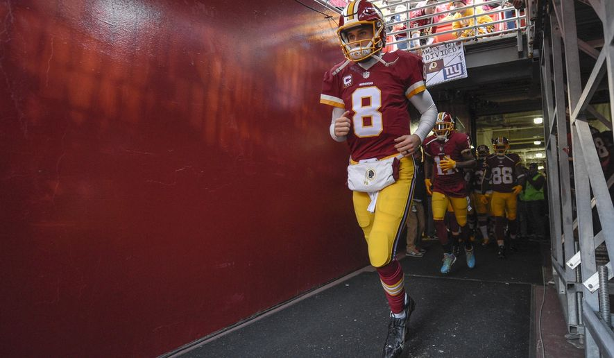 FILE - In this Jan. 1, 2017, file photo, Washington Redskins quarterback Kirk Cousins (8) runs onto the field before an NFL football game against the New York Giants in Landover, Md. The NFL salary cap for the upcoming season will be $167 million per team, up more than $12 million over last year. This is the fourth consecutive year the cap has risen at least $10 million. (AP Photo/Nick Wass, File)