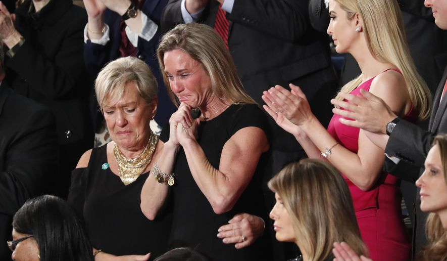 """An emotional Carryn Owens, widow of widow of Chief Special Warfare Operator William """"Ryan"""" Owens, on Capitol Hill in Washington, Tuesday, Feb. 28, 2017, as she was acknowledged by President Donald Trump during his address to a joint session of Congress.  (AP Photo/Pablo Martinez Monsivais)"""